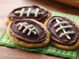 Peanut Butter shaped footballs topped with choc icing how cute!