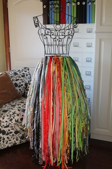 Awesome ribbon storage!!! I'd go out and buy tons of ribbon just to have this on display in a craft room!
