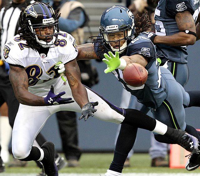 Seattle safety Earl Thomas breaks up a pass intended for Baltimore's Torrey Smith. Thomas led the Seahawks with seven tackles in their 22-17 victory.