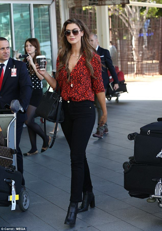 Ring-ing in the New Year? Delta Goodrem flaunts a band on THAT finger after wedding rumour... #deltagoodrem #celebrities