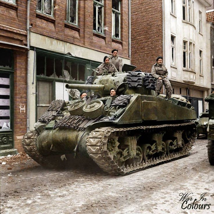 A Sherman tank of 8th Armoured Brigade (possibly 4th/7th Royal Dragoon Guards) in Amsterdamerstraße, Kevelaer, Germany. 4 March 1945.