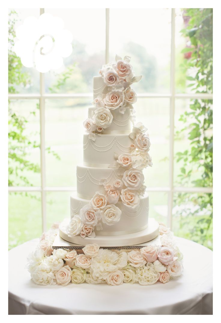 Modern striking sugar rose cascade floral wedding cake (photo credit: Jojo Stott photography)