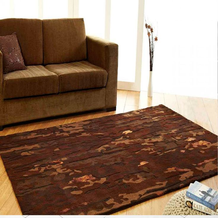Earth Abstract Design Unique Rug by Ultimate Rug Incorporate this Earth Abstract Design Unique Rug by Ultimate Rug into your home to attain a natural feel. Its wonderful abstract design with the dark brown colour like soil will give you the feeling as if you are sitting in a natural environment. #woolrugs #luxuryrugs #brownrugs #abstractrugs #handmaderugs #modernrugs