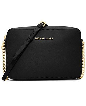 Get a fresh perspective on cool handbag decorum with this sophisticated yet street-chic crossbody from Michael Michael Kors. Fashioned in luxe Saffiano leather with gilded hardware, the adjustable str