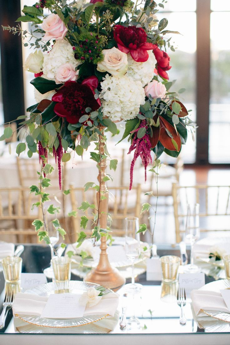 Tall white and red centerpieces with gold details - Jimmy and Brooke Romantic Southern Wedding | flowers: Enchanted Florist - photography: AIS Portraits - ceremony venue: Wightman Chapel at Scarritt Bennett - reception venue: The Bridge Building