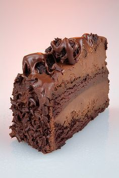 Chocolate Spoonful Cake - triple chocolate cake, with a chocolate sour cream filling - Epicurious