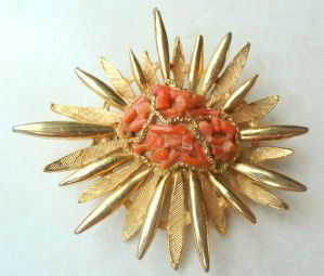 Vintage large faux coral sun burst brooch by vintage designer Exquisite.