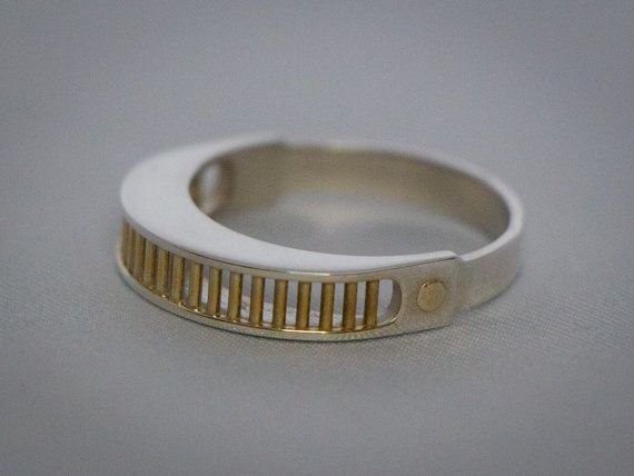 This sterling silver ring with 24K gold plated accents is inspired by the VISOR worn by Geordi LaForge in Star Trek: The Next Generation. Let your inner trekkie shine. :) This ring is made using 3D printing technology and is made to order. Default size is US 9, but half sizes from 8 - 12 are possible at this time. https://www.etsy.com/listing/129697840/star-trek-tng-geordi-laforge-visor-ring