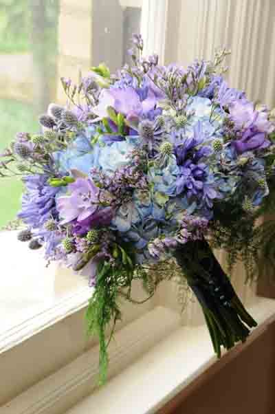 Pretty bouquet of lavenders and light blues.