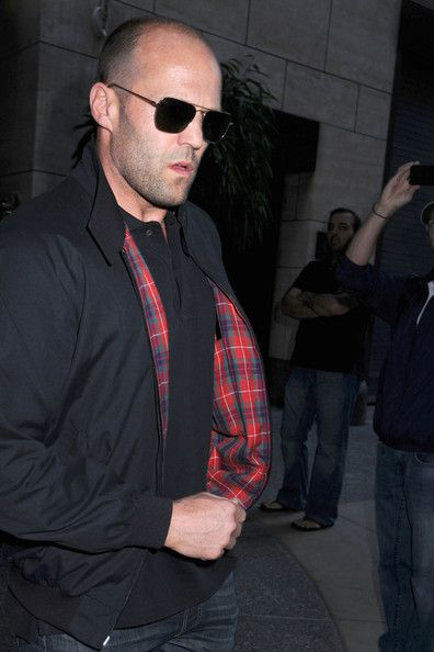 """Jason Statham Photos Photos - Trouble in paradise? Rosie Huntington-Whiteley looks downcast as she leaves her Manhattan hotel with boyfriend Jason Staham trailling behind. The Victoria's Secret model/actress was in town for he premiere of her movie debut in """"Transformers 3: Dark Side og the Moon"""". - Rosie Huntington Whiteley and Jason Statham in Manhattan"""