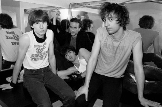 UNITED STATES - JUNE 22: PALLADIUM Photo of Michael STIPE and Mike MILLS and REM and Peter BUCK and Bill BERRY, L-R: Mike Mills, Michael Stipe (back), Bill Berry (lying in front), Peter Buck - posed, group shot, backstage in dressing room (Photo by Richard E. Aaron/Redferns)