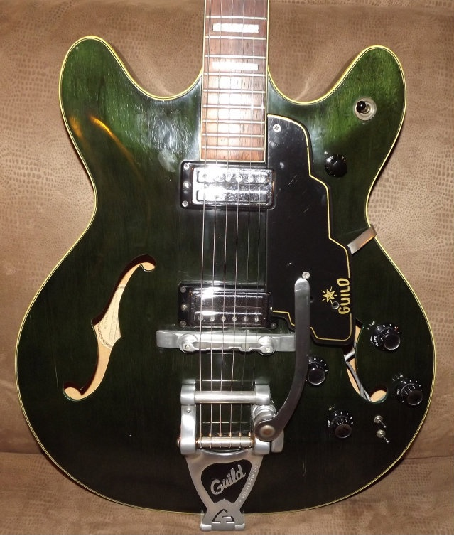 Emerald Green Guild Starfire. Late '60s. James Mercer of the Shins has one. Saw him play it in a Shins show at Terminal 5 in NYC we paid 50 bucks a ticket for, and at which they only played for 67 minutes. Bastards. Nice Guild, though.