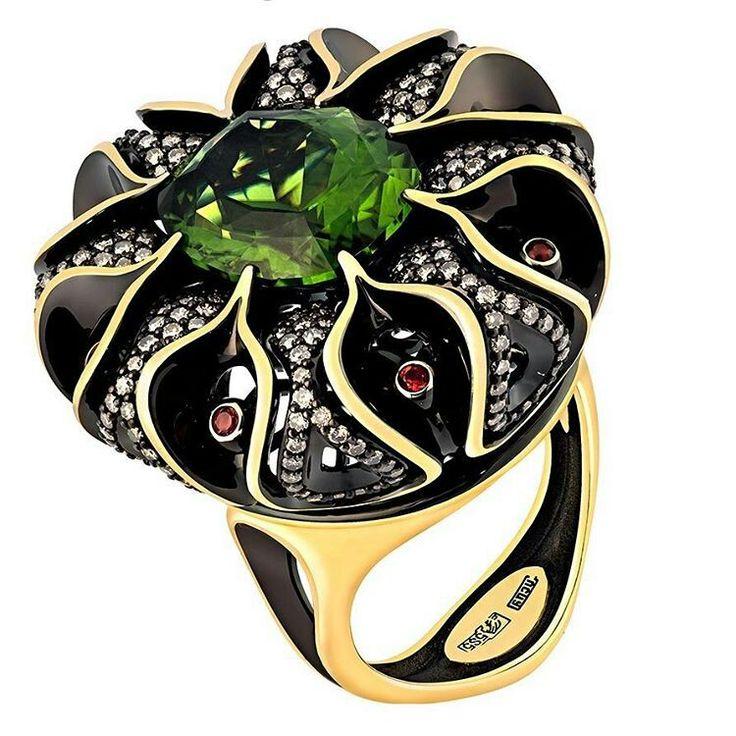 At @uvgost. Peridot black enamel on gold and diamonds