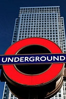 A London Underground sign and One Canada Square, the second tallest building in the UK situated at Canary Wharf, London, England