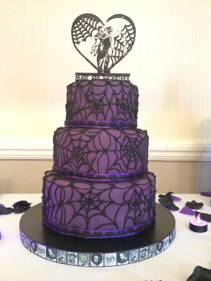 Purple and black sparkly spiderweb Goth Wedding Cake with bats and horror movie ribbons
