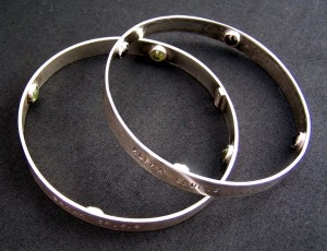 Southern Cross Bracelets from Buster Collins. Sterling silver, stamped on the outside with the names of the four stars of the Southern Cross and set with four stones on the inside. (shhh... secret stones...)