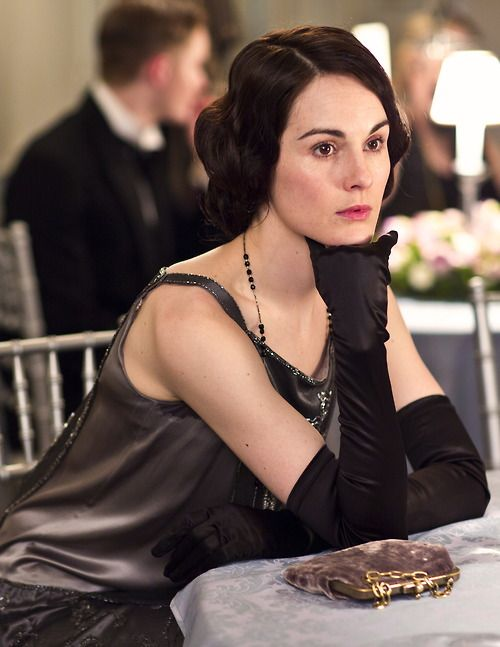 Michelle Dockery as Lady Mary Crawley looking pensive on Downton Abbey.