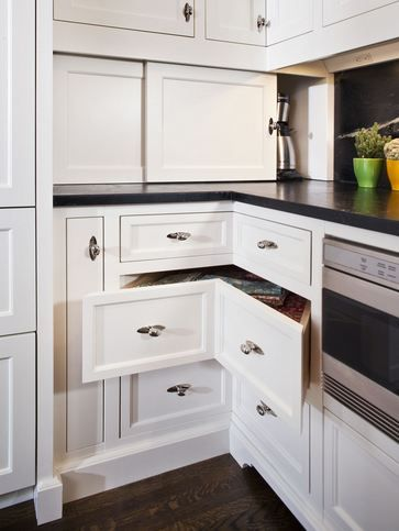 "Definitely a more ""designerly"" look, and I can't say enough about the improved space and function.  Corner drawers take advantage of the diagonal depth in that space, and are built much deeper than standard depth drawers.  Plus, they just have a more custom ""fitted"" appearance than a typical lazy susan cabinet."