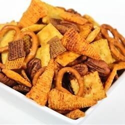 Savory, salty, crunchy, and sweet! All the flavors and textures you crave are in this interesting snack mix made from cereal, crackers, pretzels, and nuts, baked with a buttery, slightly spicy seasoning.