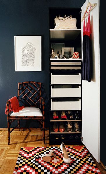 A bamboo fretwork chair adds a sense of history to this dressing area, outfitted with a modern wardrobe.