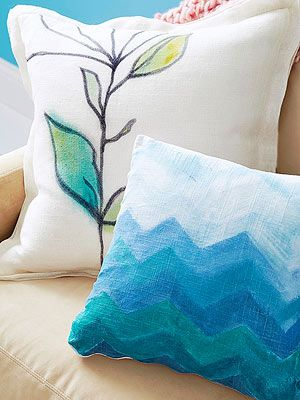 "Better Homes & Gardens shares a few how-to's with Chalk Paint® and says: ""To achieve a watercolor effect with Chalk Paint® on fabric, simply dampen the fabric with water before painting it. For an ombre effect, dillute your paint with a little more white for each stripe. Here, we alternated chevrons in blue and teal, drawing them on freehand."""