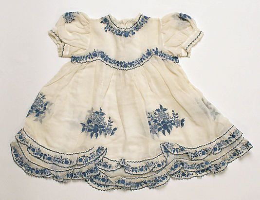 Dress    Date:      ca. 1940  Culture:      European  Medium:      cotton  Dimensions:      Length at CB: 17 in. (43.2 cm)  Credit Line:      Gift of Egon von Furstenberg, 1982  Accession Number:      1982.277.2