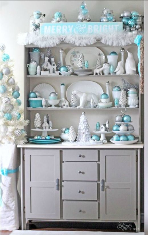 Turquoise Christmas Decorations dress up this Hutch of white dishes into something spectacular!