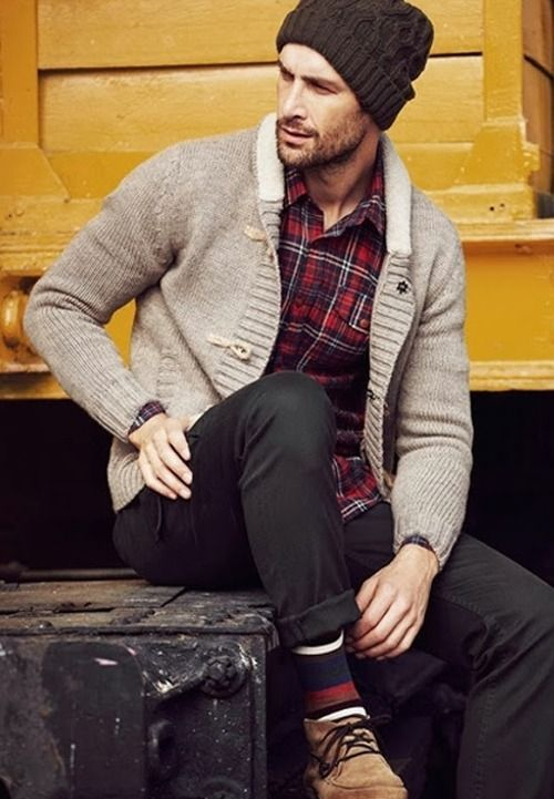 Try pairing a grey shawl cardigan with black chinos for a sleek elegant look. Complement this stylish look with tan suede desert boots.  Shop this look for $154:  http://lookastic.com/men/looks/beanie-and-longsleeve-shirt-and-shawl-cardigan-and-chinos-and-socks-and-desert-boots/4020  — Dark Brown Beanie  — Red Plaid Longsleeve Shirt  — Grey Shawl Cardigan  — Black Chinos  — Navy Horizontal Striped Socks  — Tan Suede Desert Boots