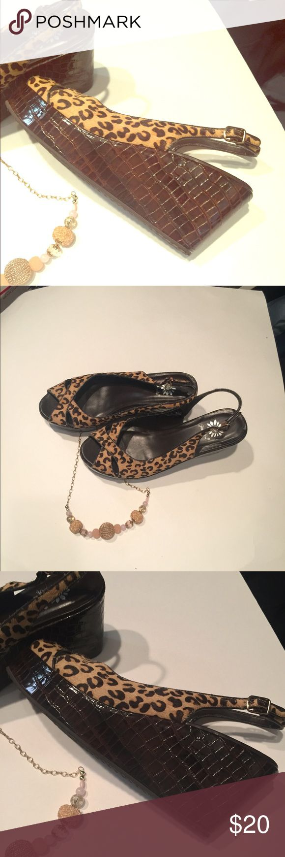"""👡🐯leopard wedges☺️ Eye catching leopard wedges with strap.  3"""" wedge and roomy 🌸slight scuffs on top of shoe and strap due to wear (shown in pics)💐 Yellow Box Shoes Wedges"""