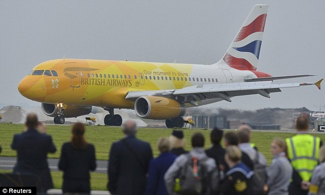 Arriving on board a special golden liveried British Airways flight from Athens, the Airbus plane 'Firefly' Flight 2012 touched down at RNAS Culdrose, Cornwall at 7.25pm  The flame has landed :-)