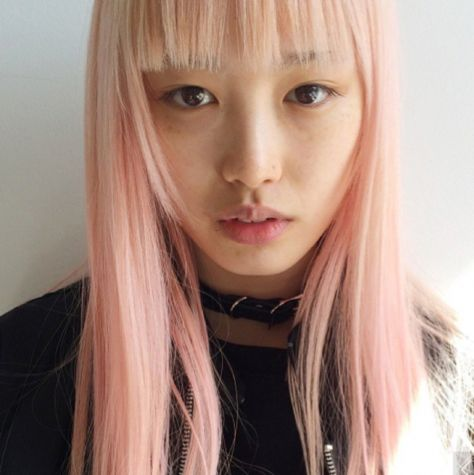Supermodel Fernanda Ly does her own hair using Manic Panic in Cotton Candy Pink.