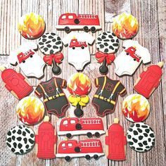 Firefighter themed baby shower cookies. Complete with fire hydrant baby bottle! #firefightercookies #BabyShowerCookies #decoratedsugarcookies #SweetTemptationsByNicole