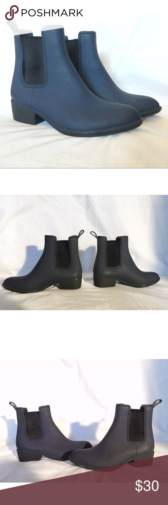 Jeffery Campbell Stormy rain boot Dark blue and black Chelsea style rain boot with a pointed toe. Elastic sides. Pull on. Size 10 but they run small. Great condition with only a few marks from wear. The last photo shows ink from a barcode, but it's not noticeable when worn. The ink came on them when bought from urban. Jeffrey Campbell Shoes Winter & Rain Boots