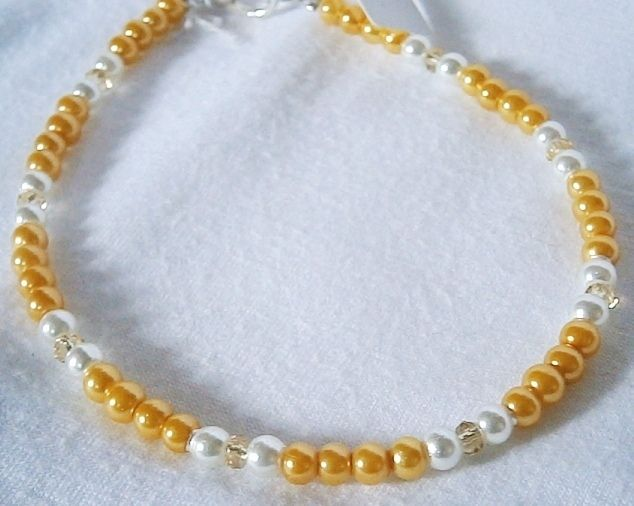 GOLD & WHITE BEADED ANKLET £6.00http://folksy.com/items/6243781-GOLD-WHITE-BEADED-ANKLET