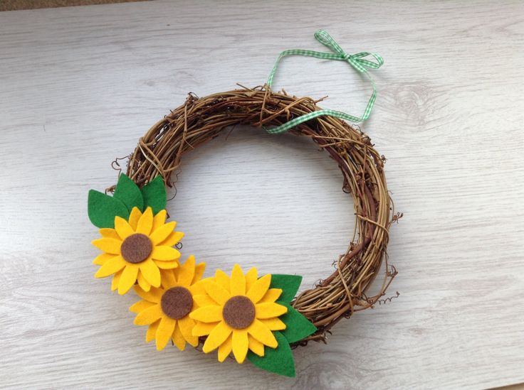 A personal favorite from my Etsy shop https://www.etsy.com/listing/234340895/sunflower-rattan-wreath