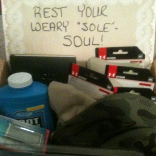 """Rest your weary """"sole""""- soul care package. Contents include under armour boot socks , manicure set for men , foot powder, shower shoes, boot cushions, foot lotion, & a bible"""
