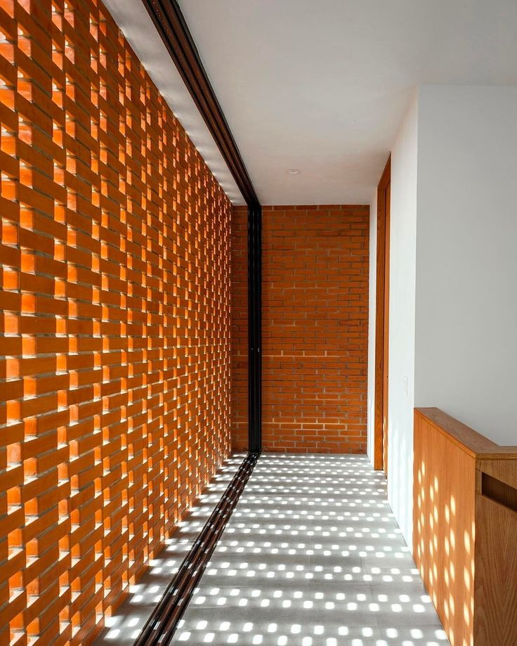 Latticed brickwork lets playful patterns of light filter inside a Guadalajara residence by @PabloAlexanderson, creating a sense of airiness and spaciousness. : courtesy of the architects. @sandow... - Interior Design Ideas, Interior Decor and Designs, Home Design Inspiration, Room Design Ideas, Interior Decorating, Furniture And Accessories