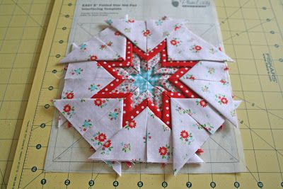 a folded star tutorial! I made these years ago, turning them into trivets I gave as Christmas that year.