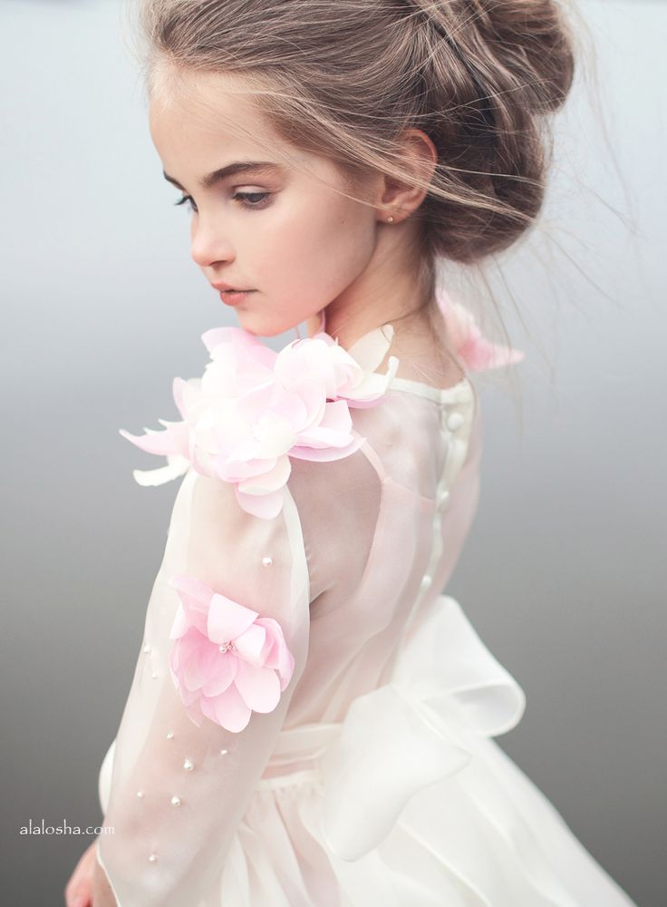 Flower lily. Subtle embroidery and embellishment placed on the garment to resemble and element from the children's book.