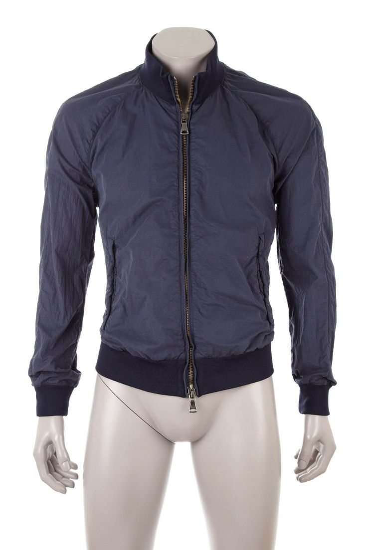 Sport jacket in techno fabric, dyed garment, diagonal piped pockets with press-stud buttons, double zip. Ribbed collar, cuffs, and bottom. REGULAR fit.