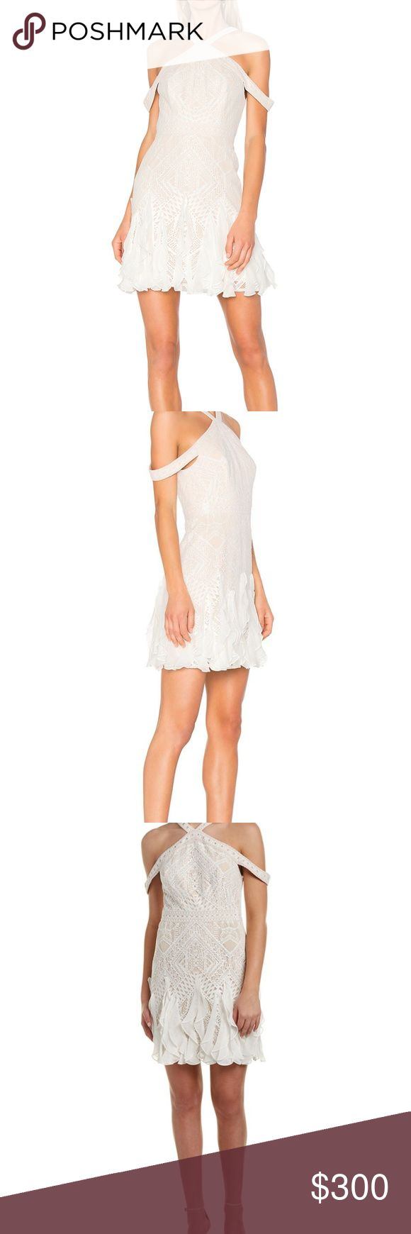 """NWT BCBG Leighann Cold-Shoulder Lace Dress With a shoulder-baring cut and flattering neckline, this party-ready dress has been crafted from textural lace with playful ruffles around its skirt.  Concealed back zipper closure Fabric body: 55% cotton, 45% nylon lace; fabric 2; 100% silk chiffon; fabric 3: 100% polyester mesh; lining: 91% polyester, 9% spandex Washable, dry clean recommended Mid-weight, stretch fabric Hits above the knee True to fit Model is approximately 5'9"""" (175cm) and…"""