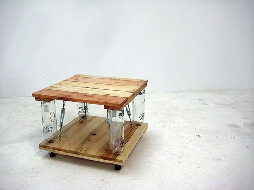 Cheap, cool coffee table design using glass bottles as spacers, and turnbuckles to keep tension on the bottles. Use any wood and any bottles for customization.