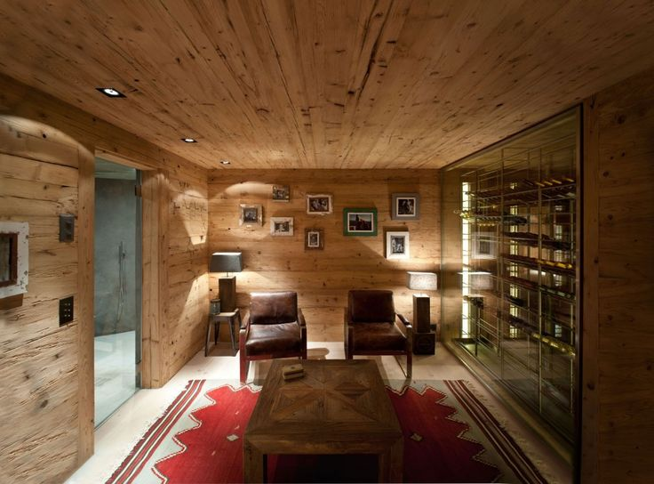 Furniture: Chalet In Gstaad Home Wine Lounge Modern Glass Wine Cellar And Rustic Leather Wood Armchair Also Traditional Wooden Coffee Table Design Adds A Wonderful Atmosphere: Excellent Furniture Wine Cellar Designs