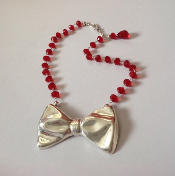 Sterling silver bow-tie pendant with red crystals