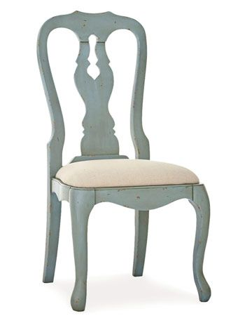This muted blue is seen in many homes especially Sweden.  Love the chair.