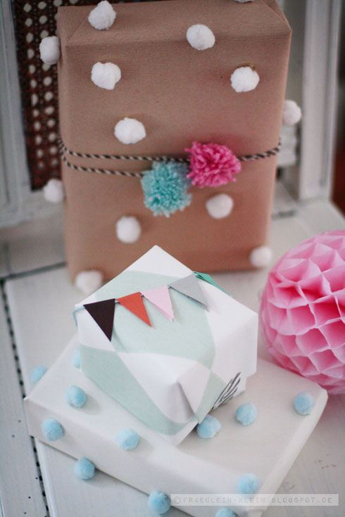 Love the little bunting topper and crazy poms