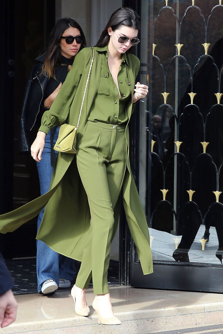 Leaving her hotel in Paris, Kendall goes monochrome in an olive green ensemble by Elie Saab with a matching bag and neutral pumps.    - HarpersBAZAAR.com