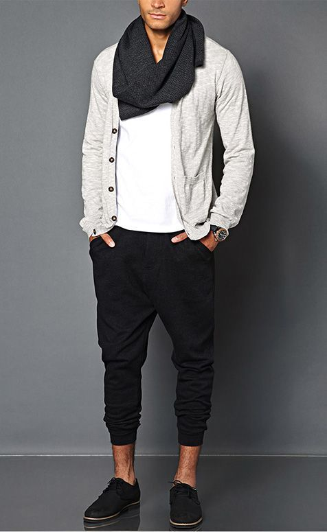 Shop this look on Lookastic:  https://lookastic.com/men/looks/cardigan-crew-neck-t-shirt-sweatpants-derby-shoes-scarf-watch/13370  — Charcoal Herringbone Scarf  — White Crew-neck T-shirt  — Grey Cardigan  — Black Leather Watch  — Black Sweatpants  — Black Suede Derby Shoes