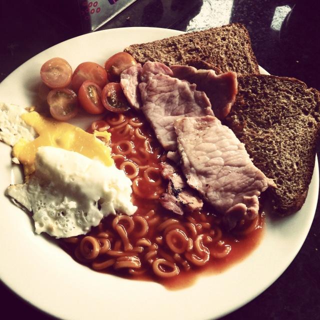 Breakfast, bacon eggs toast spaghetti hoops tomatoes