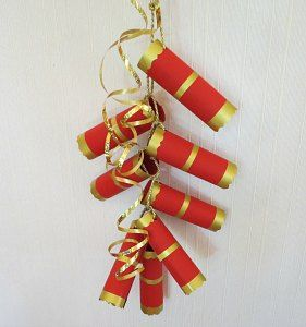 Making paper Chinese New Year firecrackers. Toilet paper rolls would be perfect for this craft.